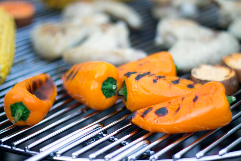 Small peppers grilling on the BBQ